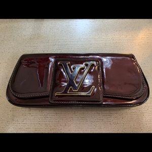 Louis Vuitton Sobe Amarante clutch